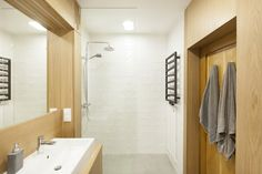 Timber Terrace - a bathroom with light showering room and wood paneling, featured on NONAGON.style