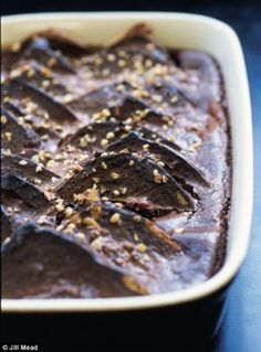 CHOCOLATE BREAD AND BUTTER PUDDING - 1 fruit bread butter 120 gram(s) dark chocolate 60 gram(s) milk chocolate 2 egg yolk(s) 300 ml double cream 85 gram(s) caster sugar 3 drop(s) vanilla essence