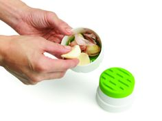 "Best Garlic Peeler: Chef'n Twist N' Peel - What it is: A plastic garlic-peeling gadget that makes easy work of skinning cloves—just give it a simple twist!  Why we love it: ""This tool makes it easy to peel multiple cloves of garlic in seconds. It's small, easy to use (just push and twist), easy to clean and there is no lingering garlic scent in the peeler or on my hands."""