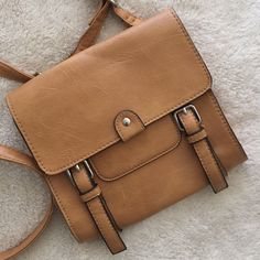 Small crossbody Used left than a handful of times! Small, tan colored crossbody. American Rag Bags Mini Bags