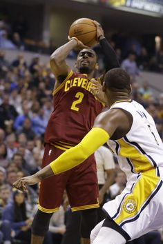 Cleveland Cavaliers guard Kyrie Irving (2) shoots over Indiana Pacers forward Lavoy Allen (5) during the first half of an NBA basketball game in Indianapolis, Monday, Feb. 1, 2016.