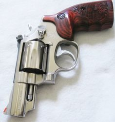 Smith and Wesson K frame Model 66 2.5 inch Barrel with Smith and Wesson custom engraved grips with S & W logo. Please visit us for more grips at http://www.ebay.com/sch/gce-sports/m.html?_nkw=&_armrs=1&_ipg=&_from=