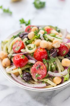 This simple cucumber noodle greek salad is a light pasta dish that can be enjoyed all year long. Easy to make, naturally vegan and packed with veggies!