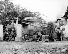 Marines effectively use walls and buildings as cover during their advance against the enemy.