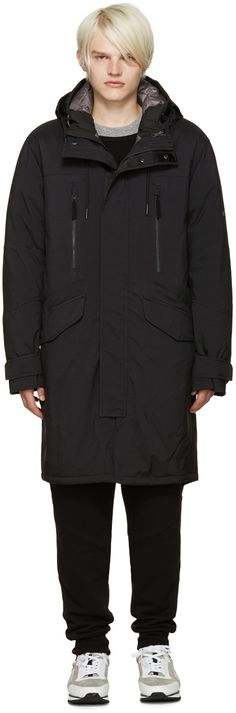 Long sleeve layered nylon parka in black. Drawstring and press-stud fastening at hood. Concealed zip closure with press-stud placket. Zippered and flap pockets at body. Drawstring-adjustable waistband. Velcro cinch strap at cuffs and back waist. Vented hem at back. Detachable zippered down-filled inner layer in black featuring hood, front zip closure, and zip pockets. Tonal hardware. Tonal stitching. Inner layer: 100% polyester.  Layer fill: 90% goose down, 10% feather.