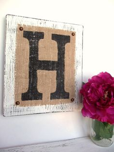 Painted burlap, tacked to wood.  LOVE