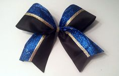 Cheer Bow-  Sparkly Blue, gold, and black. Texas size bow. So cute!! Available on Etsy! Great for a competition bow!