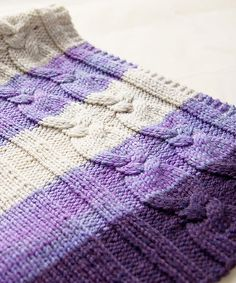 Note the purple cables...another urgent to do project...Ravelry: Cabled Blanket pattern by Megan Goodacre
