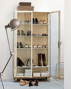 old vintage cabinet as a mudroom / shoe closet. love it but ummm I don't think mine would look this good lol!  adorable