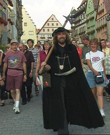 Rothenburg, Germany...One of the best tours in the world!  The Night Watchman of Rothenburg takes you on a fascinating medieval history tour of the town.  Recommended by Rick Steves.
