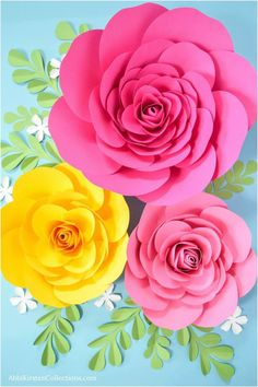 Large paper roses. Small paper roses. Wedding rose backdrop.