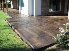 scored and stained concrete to look like wood floors on the patio....oh that would look cool in my basement slab