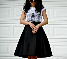 Graphic tee, circular sunnies, and a midi skirt. Fun play on a midi skirt outfit.