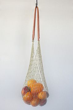 Natural colored cotton cord net bag with soft cognac leather handles by And So It Goes