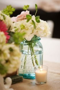 Masion jars with flowers for centerpieces