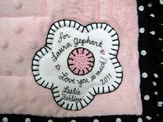 http://www.lesliefehling.com/2011/02/poodles-purses-baby-quilt.html