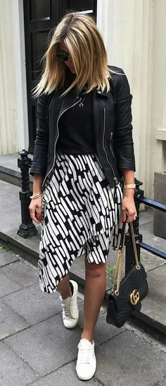 #summer #outfits Black Leather Jacket + White Sneakers + Printed  Asymmetric Skirt