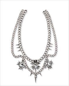 STATEMENT NECKLACE Silver-toned metal with plastic metal, $18; hm.com.