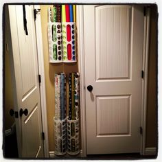 Storage solution for my wrapping paper. $2 each at IKEA.  Plastic bag holders. Behind the door in my craft room.