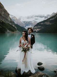 Lake Louise Elopement in the mountains of Alberta, Canada. Look at that turquoise hued water and this gorgeous bohemian bride!