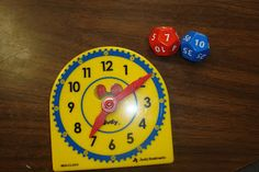 The time dice get rolled and then students use their clock to build that time...I could make a die that shows only :00 and :30, and the other die showing hours... Common Core First Grade