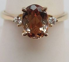 orange topaz... I have earrings, but I would love to have a topaz ring or necklace :)