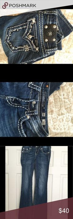 """Miss Me boot cut jeans size 26 beautiful stitching Miss Me boot cut jeans size 26 beautiful stitching not too much bling. Waist aprox 13"""" lying flat, inseam approx 32 1/2, leg opening approx 8"""". Miss Me Jeans Boot Cut"""
