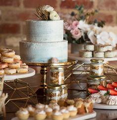Marble and gold perfection. This stunning dessert buffet is right on trend with feature marble buttercream cake sparkly donuts dessert jars and more. Photographed by the talented @immersephotographygenelle  @tanglewoodestate with beautiful flowers by @naomirosefloraldesign come see us all at the @weddingandbride expo 7th -9th of October and see for yourself the magic we can create for your wedding day Desserts and cakes by us #regniercakes #weddingdessertcake #dessertcake #dessertbuffet…