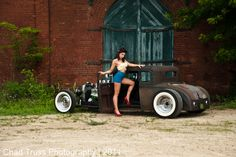 Well built Model A rat rod with a pin up model.