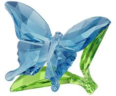 Swarovski Butterfly on Leaves --  turquoise-blue crystal on a green crystal base. Its 302 crystal facets create a stunning sparkle.