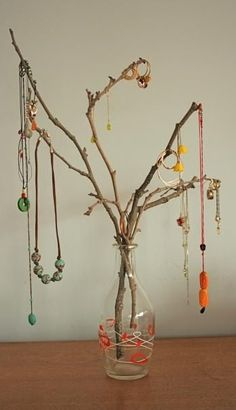 branch jewelry tree with earthy accessories for fall