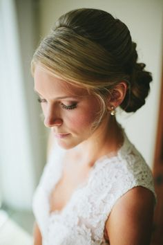 Side swept bangs and bun to one side | photography by http://braun-photography.com/