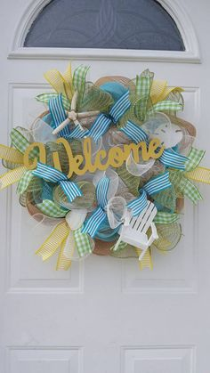 Check out this item in my Etsy shop https://www.etsy.com/listing/524640113/welcome-deco-mesh-wreath-beach-wreath