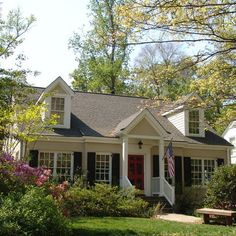 grey cape cod house, black shutters, red door, entry shape