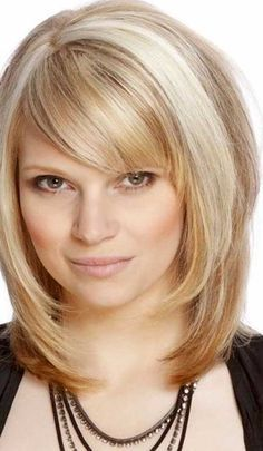 8. Medium Length Hairstyle with Bangs and Layers