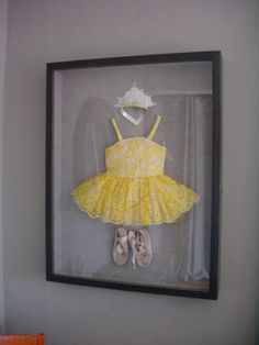 do this with first dance recital costumes and first baseball uniform. Cute!