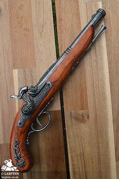 The Morgan Percussion/Flintlock Cap Pistol is an imitation century Flintlock pistol set up to fire single shot caps. This is obviously NOT A REAL GUN but an imitation cap gun suitable for larp, theater, cosplay - particularly pirate events. Rifles, Wood Folding Chair, Leather Hats, Fantasy Weapons, Larp, Firearms, Hand Guns, Pirates, Flintlock Pistol Tattoo
