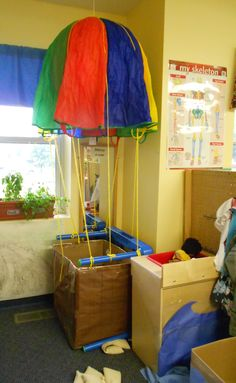 Our hot air balloon made with beach ball, parachute and cardboard box