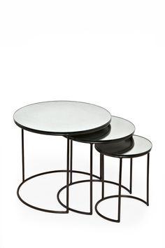 <ul> <li> Mercerised nest of tables</li> <li> Three different sizes</li> <li> Shiny round table tops</li> <li> Curve at base of legs</li> </ul>