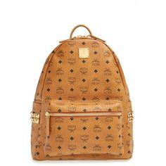 MCM 'Medium Stark' Side Stud Backpack ($725) ❤ liked on Polyvore featuring bags, backpacks, cognac, paper bag, mcm backpack, top handle bag, cognac bag and knapsack bags