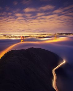 """Into the Night"" Watching the fog roll into San Francisco near the Golden Gate Bridge.  by shainblumphotography"