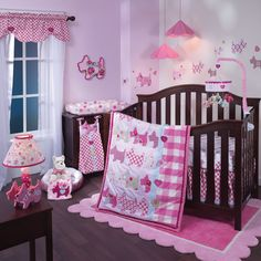 Lambs and Ivy Puppy Tales Baby Bedding Collection: This adorable nursery theme combines puppies and plenty of pink that is perfect for your little girl. We love this set because it has plenty of mix and match accessories that you can get with the adorable pups and colors to make the crib bedding to truly make your room look great! http://www.babybeddingandaccessories.com/lambs-and-ivy-puppy-tales-baby-bedding-collection/