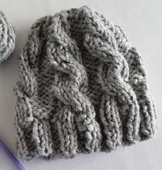 This chunky, cable knit hat pattern is as warm as it looks. The Winter Bonfire Hat is the quintessential cold weather knit accessory.