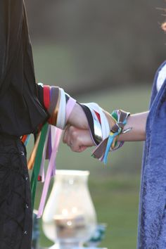 Much of the beauty of the handfasting ritual comes from the tools and materials that are used, all of which have symbolic meaning, mostly relating to love and spirituality, and all deeply profound. The priest ties the couple's hands together to symbolize their union. The bride and groom carefully select the colors of the ribbons for the cord to be used to bind their hands. Red, of course, symbolizes passion. Green represents fertility and new beginnings.
