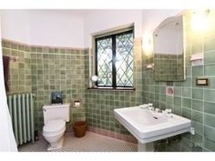 Loving the vintage tile bath in this Riverside IL home for sale