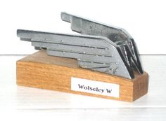 Wolseley Car Mascot - Winged 'W' fitted to most Wolseleys in one form or another over the years. This one from a Wolseley 14/60 which was a Morris 14 in all but name.  Marked M874/1 to the underside.