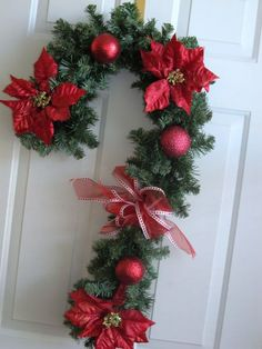 Items similar to Candy Cane shaped door wreath. Red and white metallic stripe. With apple green holly accents. on Etsy Items similar to Candy Cane shaped door wreath. Red and white metallic stripe. With apple green holly accents. on Etsy Easy Christmas Decorations, Christmas Swags, Holiday Wreaths, Rustic Christmas, Simple Christmas, Christmas Crafts, Christmas Ornaments, Etsy Christmas, Christmas Angels