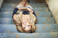 senior picture portrait idea natural urban stairs laying down