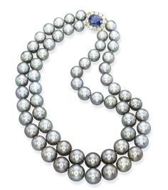 A GREY SOUTH SEA CULTURED PEARL NECKLACE  Comprising two rows of thirty-three and twenty-nine grey cultured pearls measuring from 10.5 to 15.1 mm to the sapphire and diamond cluster clasp, mounted in 18k yellow gold