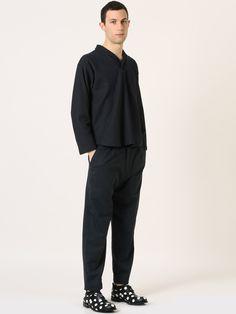 Federico wears CAMO by Stefano Ughetti BOHDAN sweater and PATRICK trousers